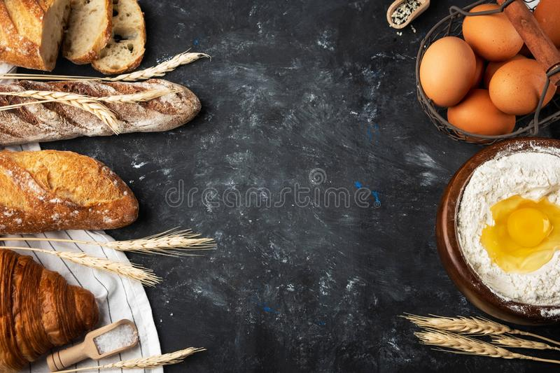 Assortment of fresh bread, baking ingredients. Still life captured from above, banner layout.Healthy homemade bread. royalty free stock images
