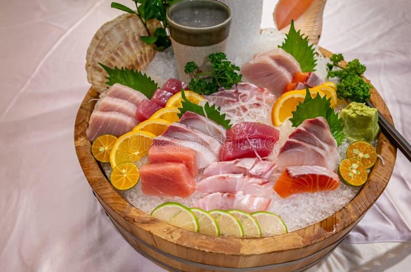 Assortment of Fresh Delicious Sashimi on Ice stock photo