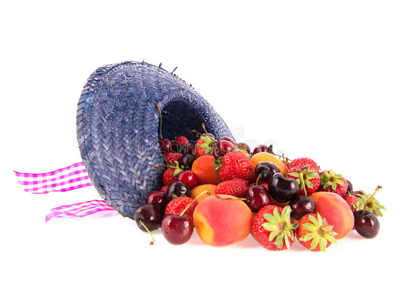 Assortment fresh fruitin summer hat stock image
