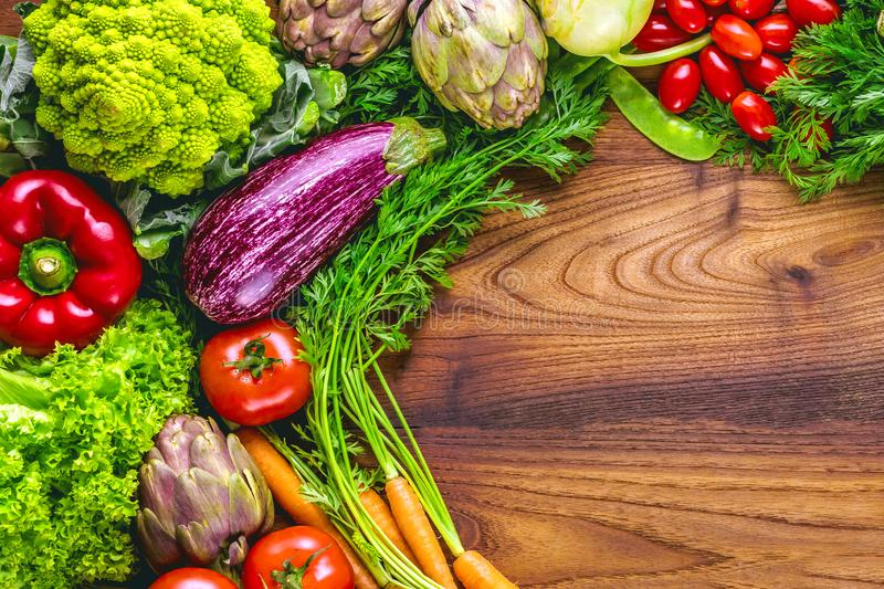 Assortment of fresh fruits and vegetables with copy Space wooden background stock photos