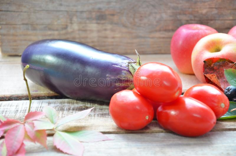 Assortment of fresh fruits and vegetables. autumn harvesting vegetables - eggplant tomatoes zucchini sweet pepper royalty free stock images