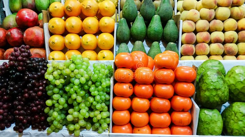 Assortment of fresh fruits and vegetables on market counter royalty free stock image