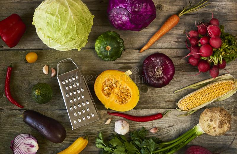 Assortment of fresh fruits and vegetables on wooden background, royalty free stock images