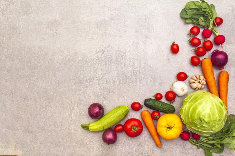 Assortment fresh organic vegetables. Food cooking stone background. Healthy vegetarian vegan eating concept, top view copy space royalty free stock images