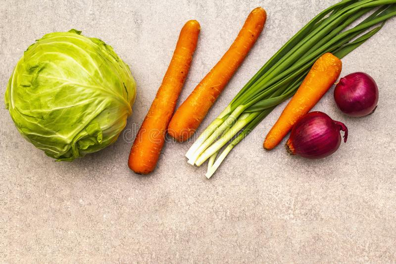 Assortment fresh organic vegetables. Food cooking stone background. Ingredients for cole slaw salad. Healthy vegetarian vegan royalty free stock photo
