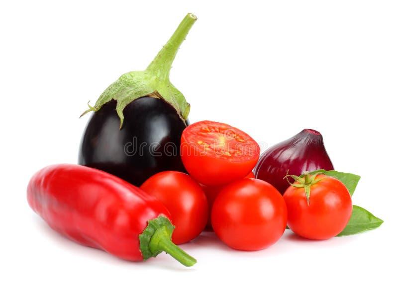 Assortment of fresh raw vegetables isolated on white background. Tomato, eggplant, onion, chili pepper, garlic, spices. stock photo
