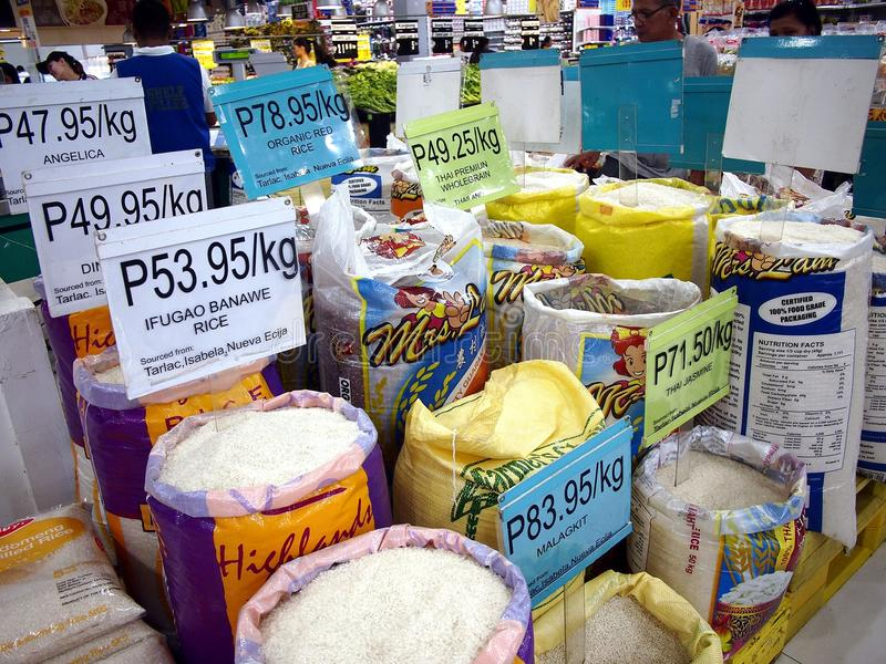 An assortment of fresh uncooked commercial rice on sale at a grocery store. ANTIPOLO CITY, PHILIPPINES - JUNE 19, 2017: An assortment of fresh uncooked stock photo