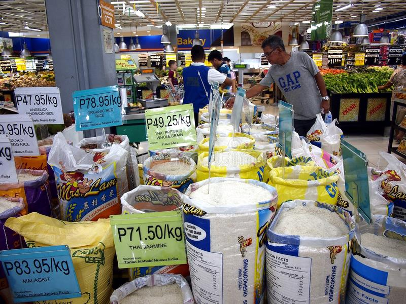 An assortment of fresh uncooked commercial rice on sale at a grocery store. ANTIPOLO CITY, PHILIPPINES - JUNE 19, 2017: An assortment of fresh uncooked stock images