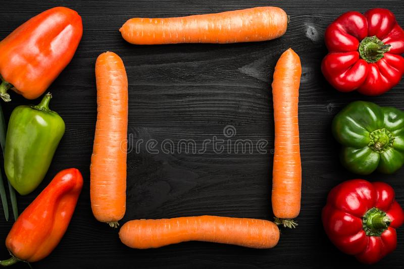 Assortment of fresh vegetables. Carrots and peppers in many colors, space for writing royalty free stock image
