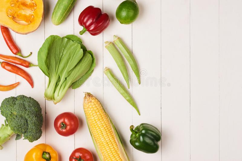 Assortment of the fresh vegetables on wooden background royalty free stock photos