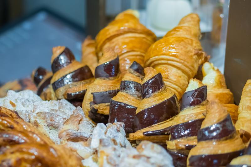 Assortment of freshly baked croissants for sale on counter of french bakery royalty free stock images
