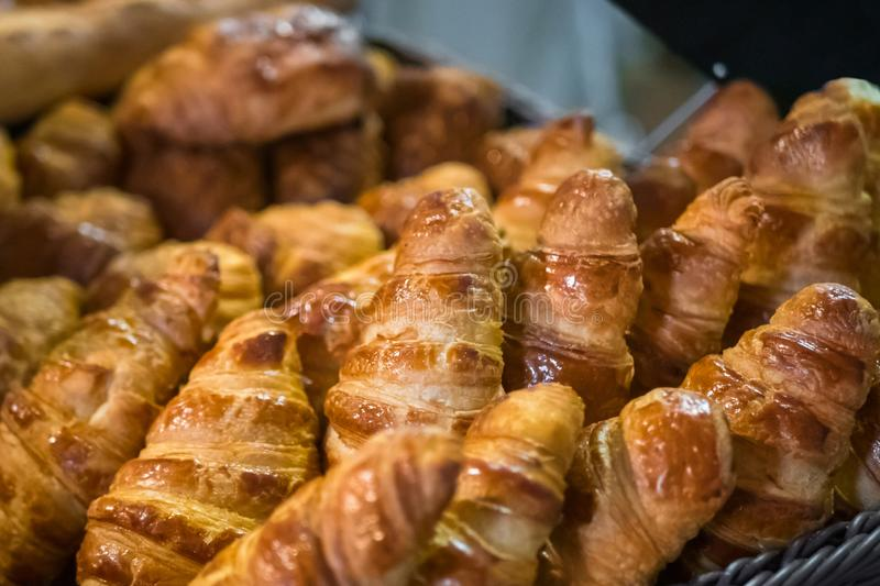 Assortment of freshly baked croissants for sale on counter of french bakery. Assortment of freshly baked croissants for sale on counter of shop, market, cafe or royalty free stock image