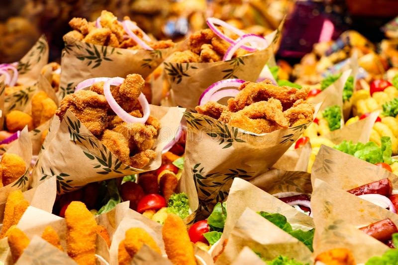 Assortment of fried seafoods for sale at Barcelona food market. Quick fried seafood available at the Barcelona food market royalty free stock photos