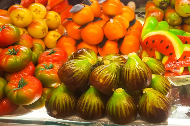 An assortment of fruit shaped marzipan - figs, tomatoes, mandarrins, watermelon in Venice, Italy royalty free stock photos