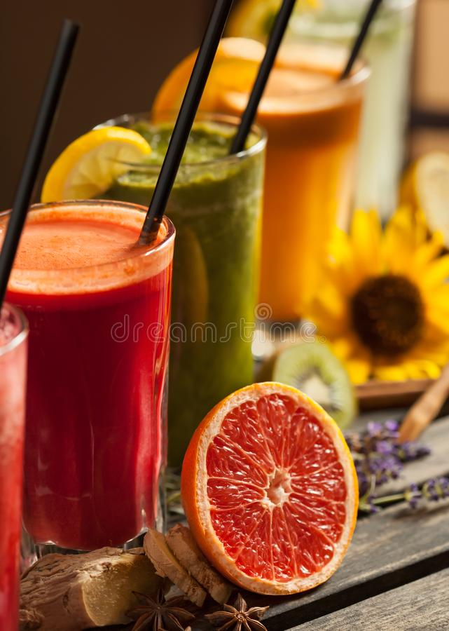 Assortment of fruit smoothies on wooden table stock photos