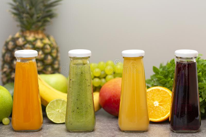 Assortment of fruit and vegetables smoothies in glass bottles. Fresh organic Smoothie ingredients. Detox, dieting or healthy food royalty free stock photography