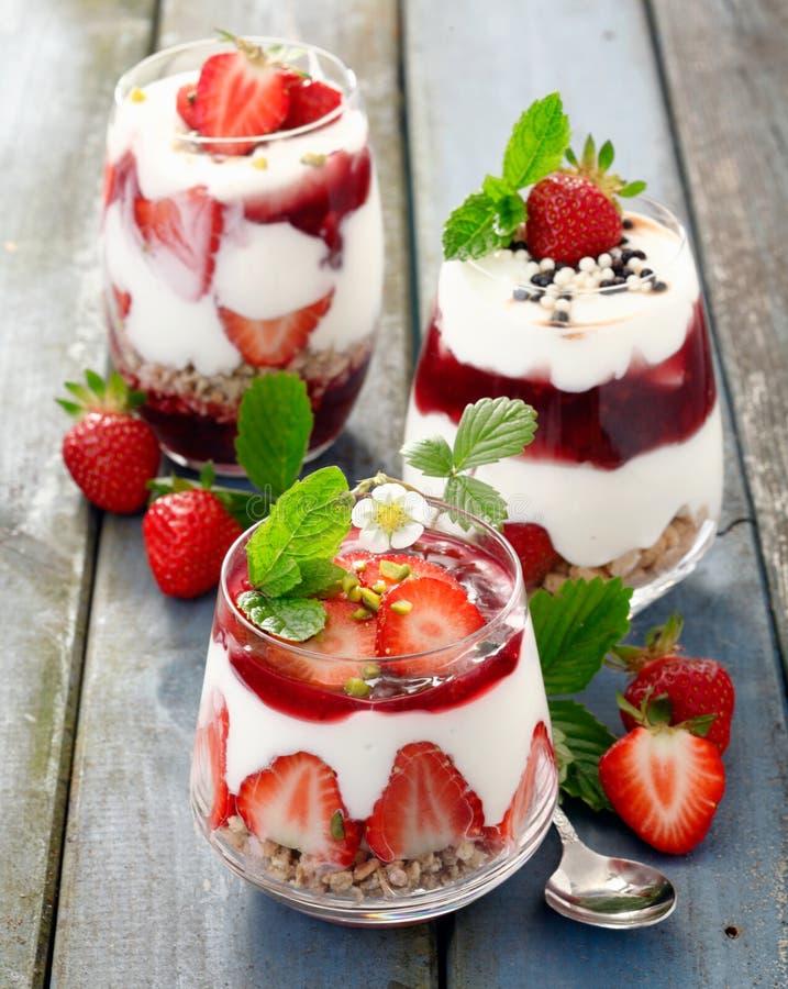 Assortment of gourmet strawberry desserts stock photo