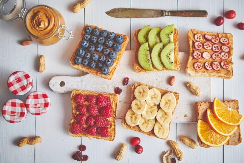 Assortment of healthy fresh breakfast toasts royalty free stock photo