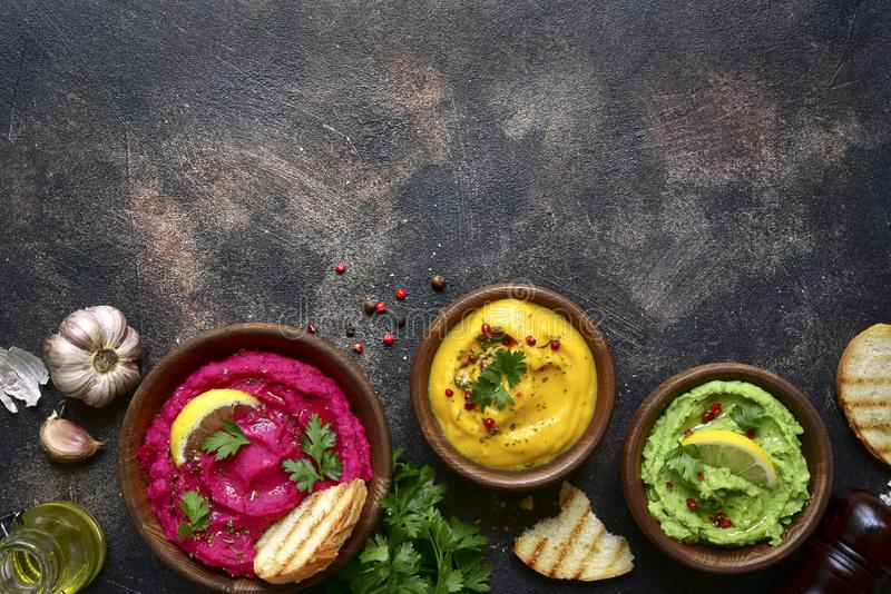 Assortment of hummus.Top view with copy space royalty free stock images
