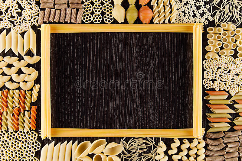 Assortment Italian Dry Pasta On Dark Brown Wooden Board With Blank ...