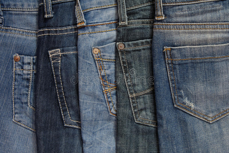 assortment of jeans stock photography