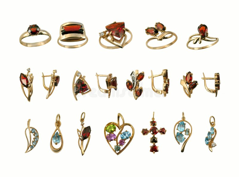 Assortment of Jewel. Variety stylish golden jewelry with gems stock image