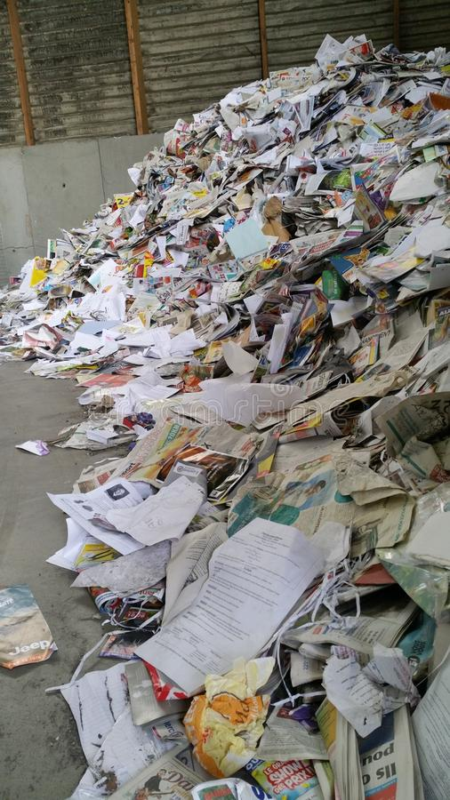 Paper piled up at recycling centre royalty free stock image