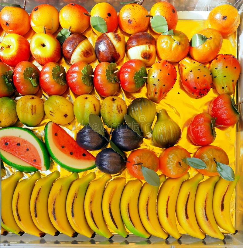 Assortment of marzipan sweets with colorful shapes of various fruits . stock image