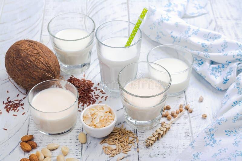 Assortment of non dairy vegan milk and ingredients stock photos