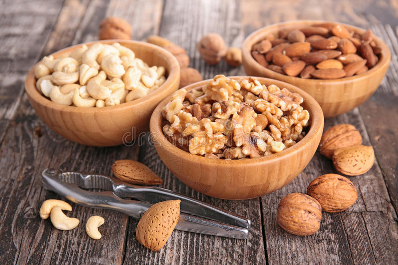 Assortment of nuts. On wood royalty free stock photo