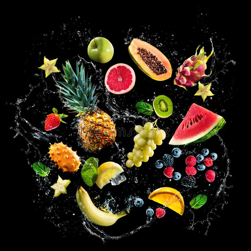 Free Assortment Of Fresh Fruits And Water Splashes On Black Background Stock Photography - 201899872