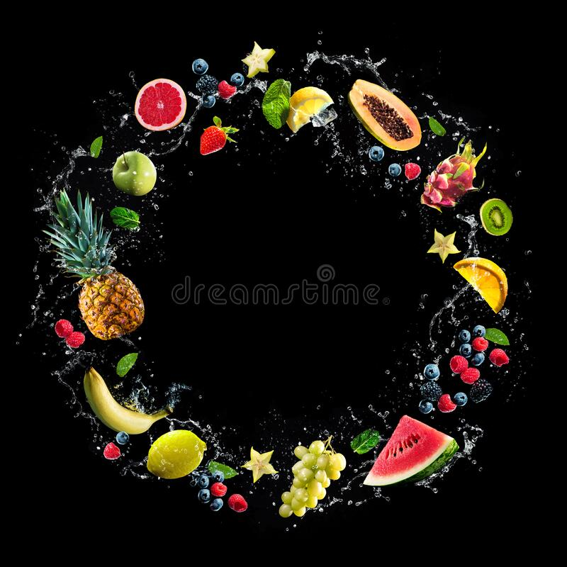 Free Assortment Of Fresh Fruits And Water Splashes On Black Background Stock Photo - 203796880