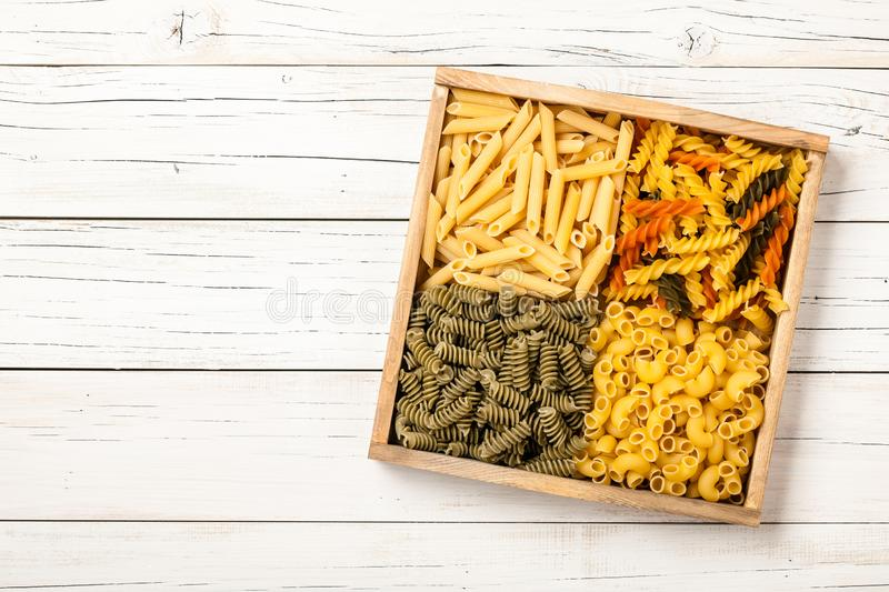 Assortment of pasta in a wooden box stock photos