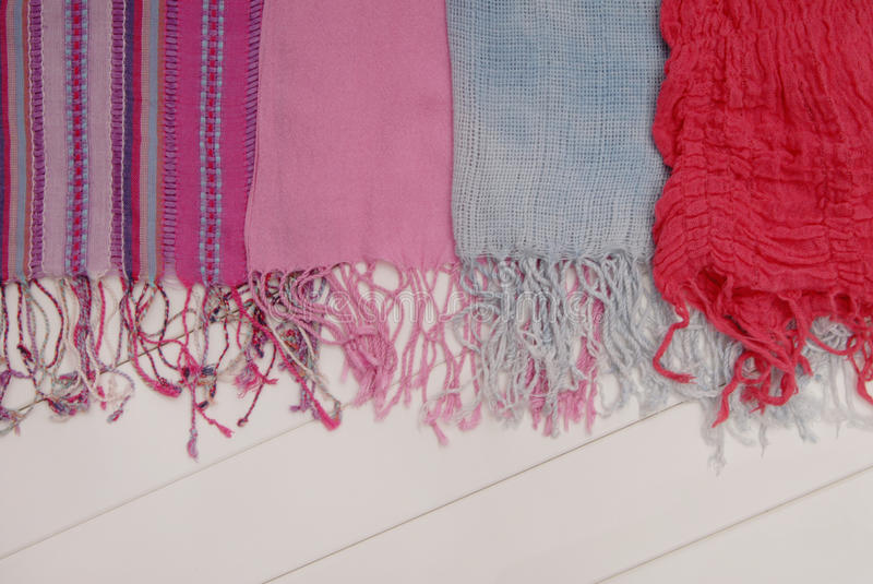 Assortment of scarfs with fringe stock images
