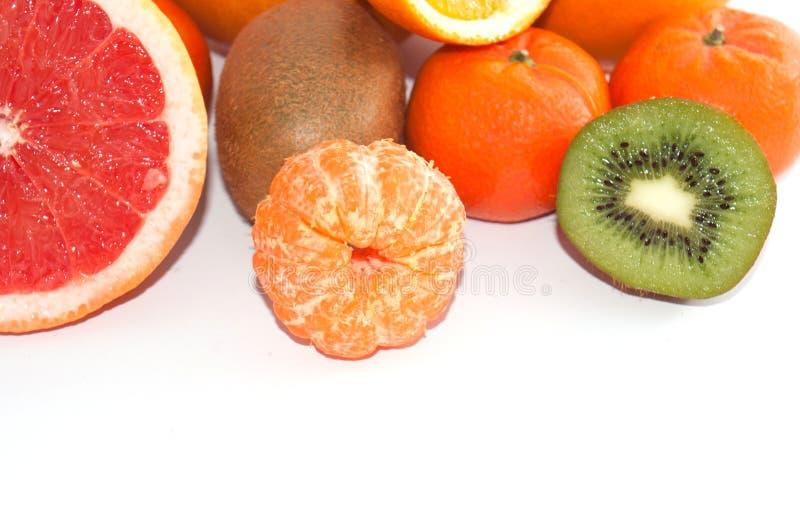 Assortment of sliced exotic fruit close up on a white background. Kiwi and Mandarin Orange Slices stock photography