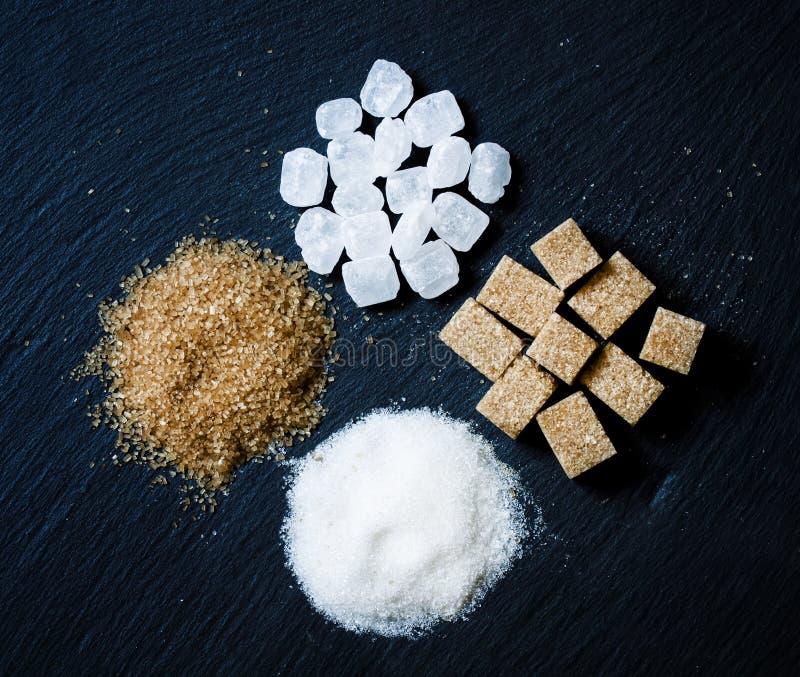 Assortment of sugar: white sand, candy sugar, brown sugar into p stock photo