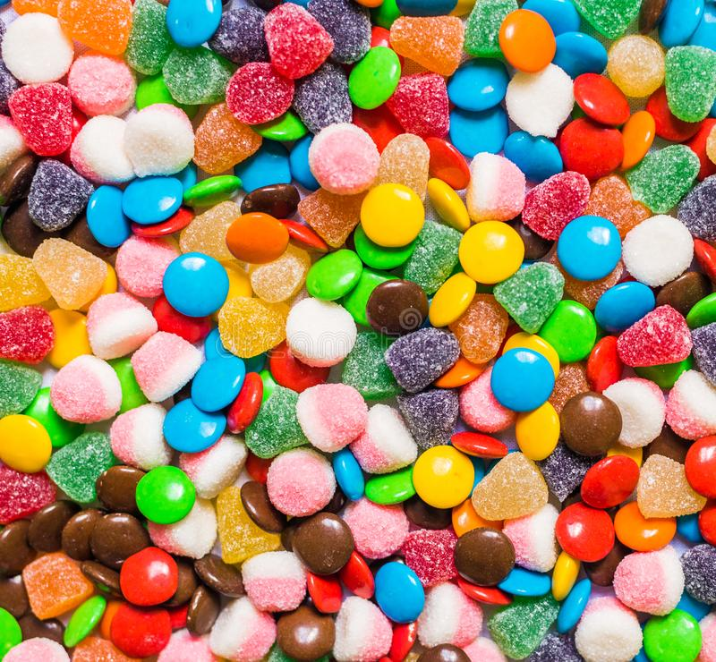 Assortment of sweet dessert colorful gummi jelly and chocolate candy.  royalty free stock photos