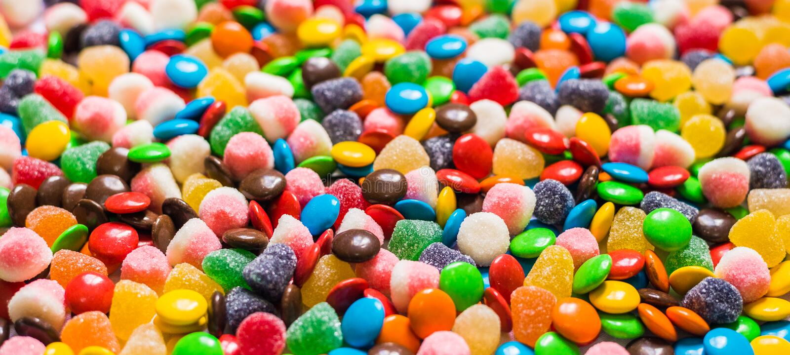 Assortment of sweet dessert colorful gummi jelly and chocolate candy.  stock images