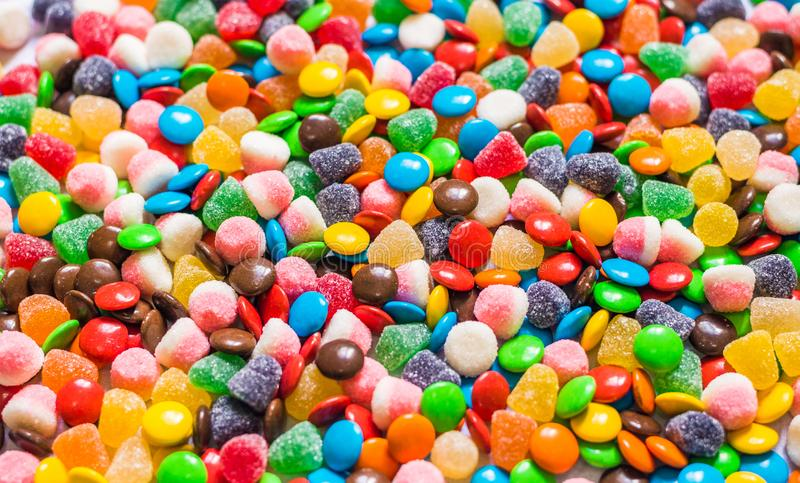 Assortment of sweet dessert colorful gummi jelly and chocolate candy.  stock photo