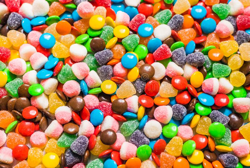 Assortment of sweet dessert colorful gummi jelly and chocolate candy.  stock image