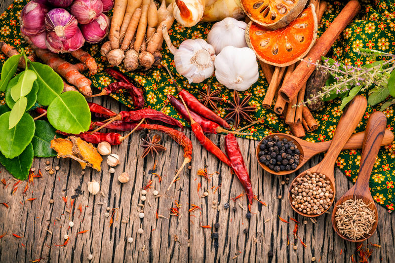 Assortment of Thai food Cooking ingredients .Red curry paste ing. Redients of thai popular food on rustic wooden background. Spices ingredients chili ,pepper stock photo