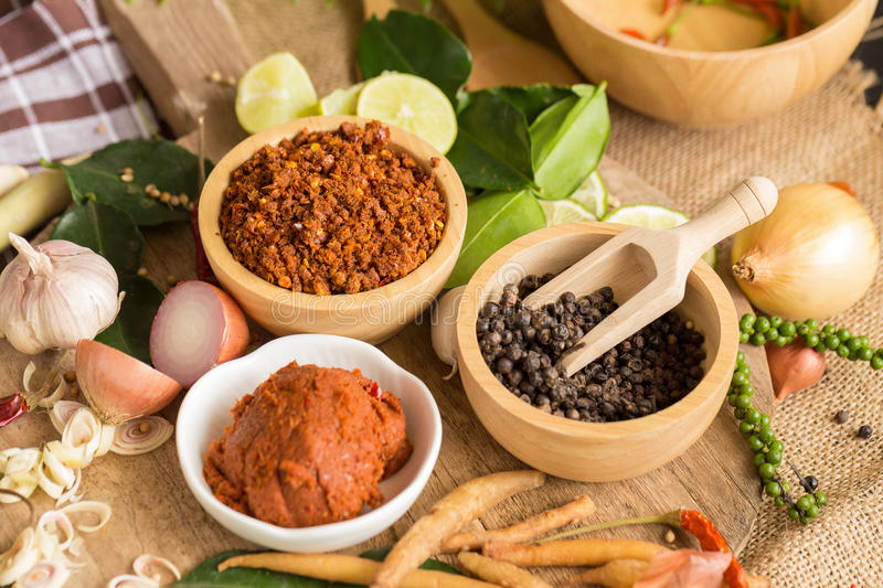 Assortment of Thai food Cooking ingredients. Spices ingredients. Chilli pepper garlicgalanga and kaffir lime leaves stock images