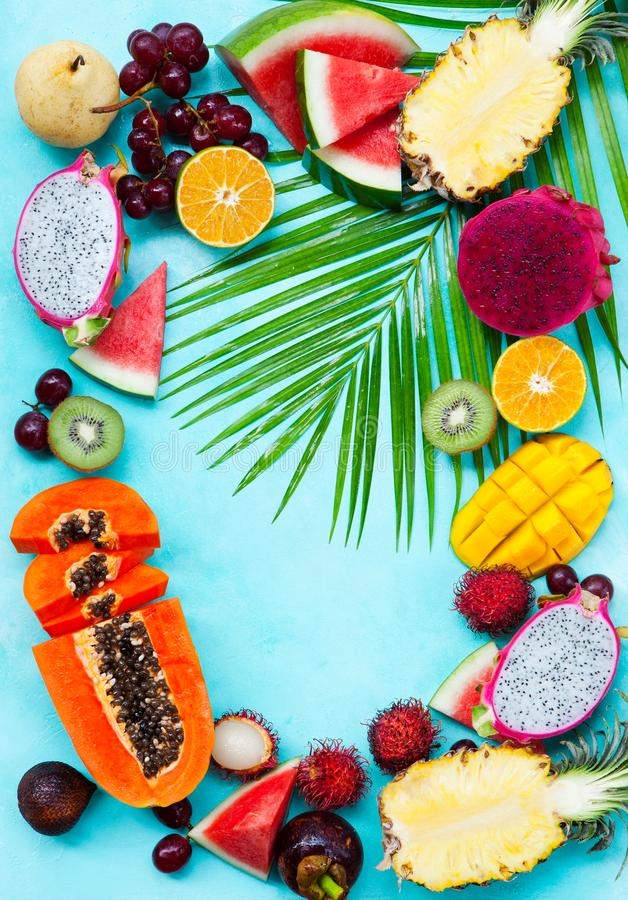 Assortment of tropical exotic fruits. Blue background. Copy space. Top view. Assortment of tropical exotic fruits. Blue background. Copy space. Top view royalty free stock images