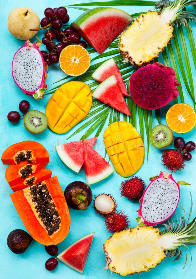 Assortment of tropical exotic fruits. Blue background. Top view. Assortment of tropical exotic fruits. Blue background. Top view royalty free stock photography