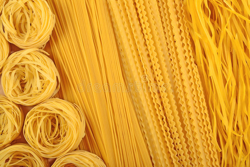 Assortment of uncooked Italian pasta as background royalty free stock image