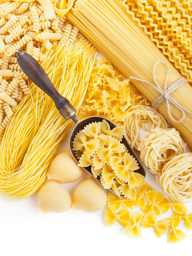 Assortment of uncooked pasta on white stock images