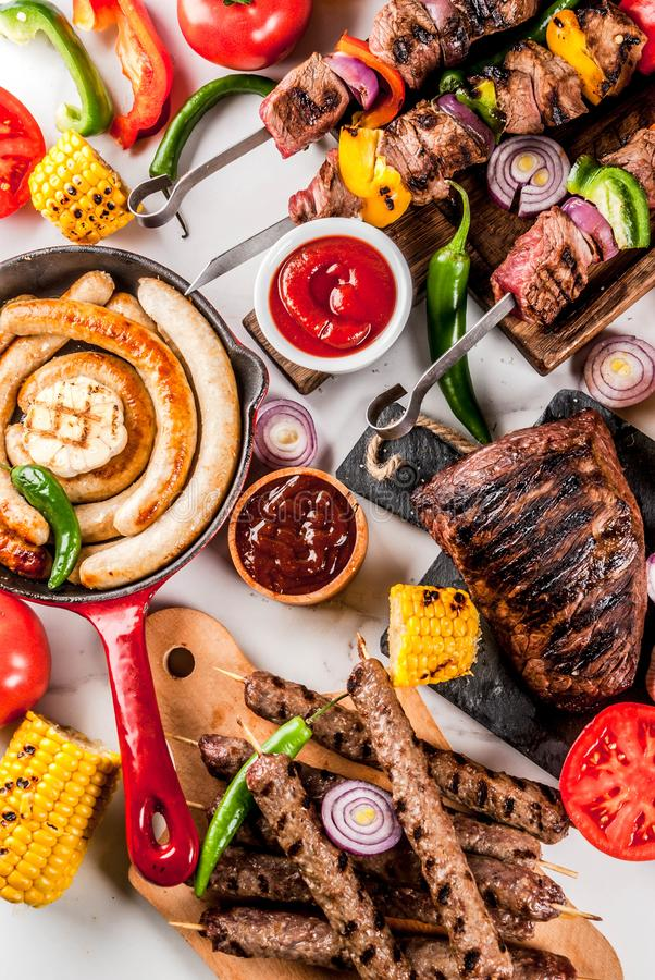 Assortment various barbecue food grill meat, bbq party fest - sh. Ish kebab, sausages, grilled meat fillet, fresh vegetables, sauces, spices, white marble stock images