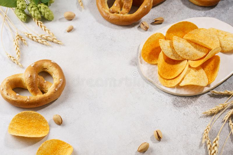 Assortment of various beer snacks - pretzels, chips, pistachios. royalty free stock photo