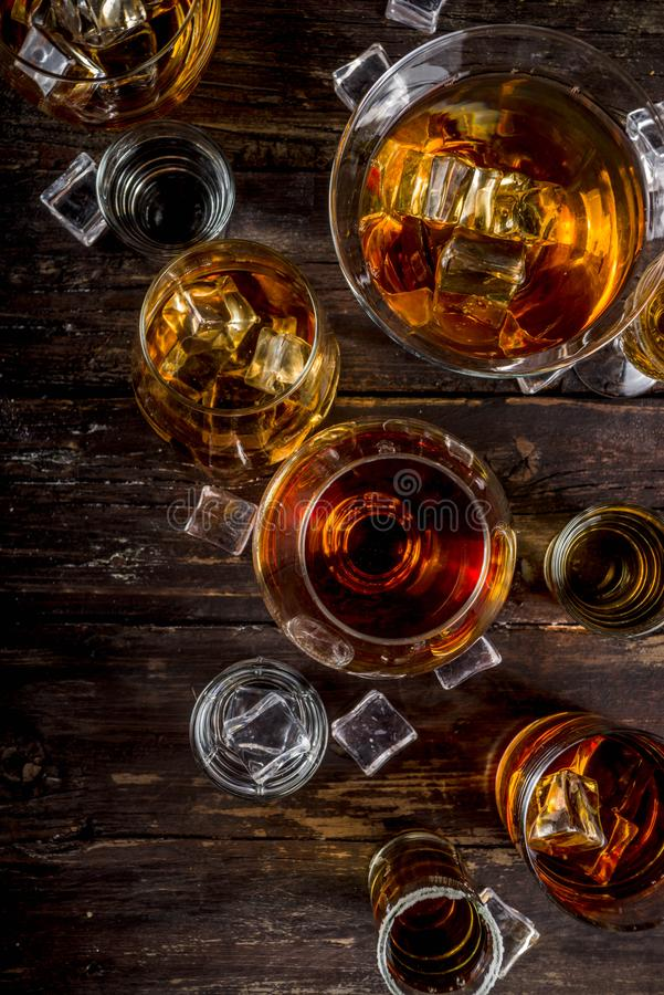 Selection of hard strong alcoholic drinks. Assortment various hard and strong alcoholic drinks in different glasses: vodka, cognac, tequila, brandy and whiskey royalty free stock photo