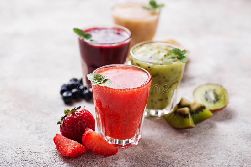 Assortment of various healthy smoothies. Selective focus stock photos